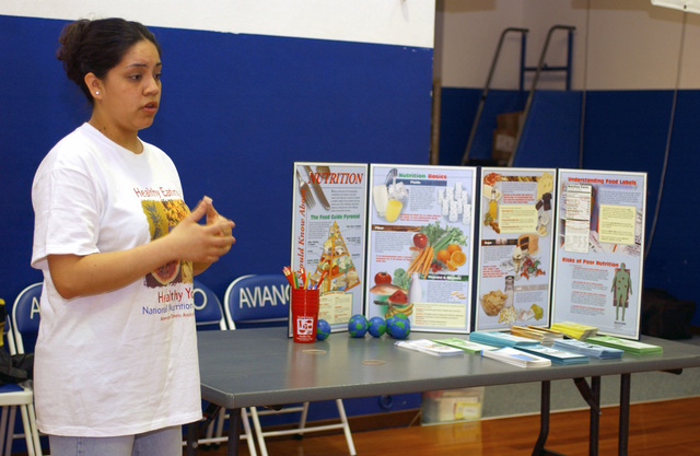 US Air Force (USAF) STAFF Sergeant (SSGT) Cybel Montiel, Fitness Instructor, 31st Medical Support Squadron (MSS), discusses healthy eating habits with students, during a class held to recognize Women's History Month, at Aviano Air Base (AB), Italy