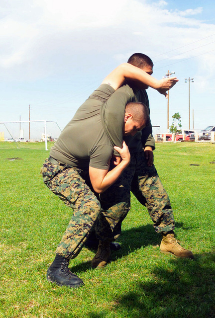 US Marine Corps (USMC) STAFF Sergeant (SSGT) Anthony R. Ochoa, and USMC Lance Corporal (LCPL) Rodolfo Espinoza, both Marine Corps Martial Arts Instructors, demonstrate a counter move to the rear choke hold, during the Marine Corps Martial Arts Program (MCMAP) at Marine Corps Air Station (MCAS), Yuma, Arizona (AZ)