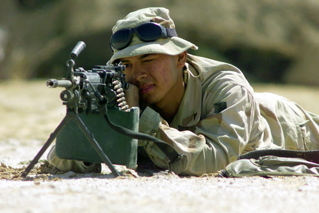 Armed with an FNMI 5.56mm M249 Squad Automatic Weapon (SAW), Lance Corporal (LCPL) Joseph Saucedo from San Marcos, Texas provides security for other Marines of Battalion Landing Team (BLT) 2/1, 15th Marine Expeditionary Unit (MEU)(Special Operations Capable) in training, during Operation ENDURING FREEDOM
