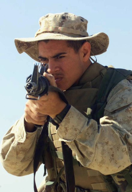 US Marine Corps (USMC) Private First Class (PFC) Rudolph Sanchez, Rifleman, 2nd Platoon, 1ST Battalion, 7th Marines (1/7), Charlie Company, Twentynine Palms, California (CA), practices entering and clearing rooms with his 5.56 mm M16A2 rifle, during Operation ENDURING FREEDOM at Camp Ripper, Kuwait
