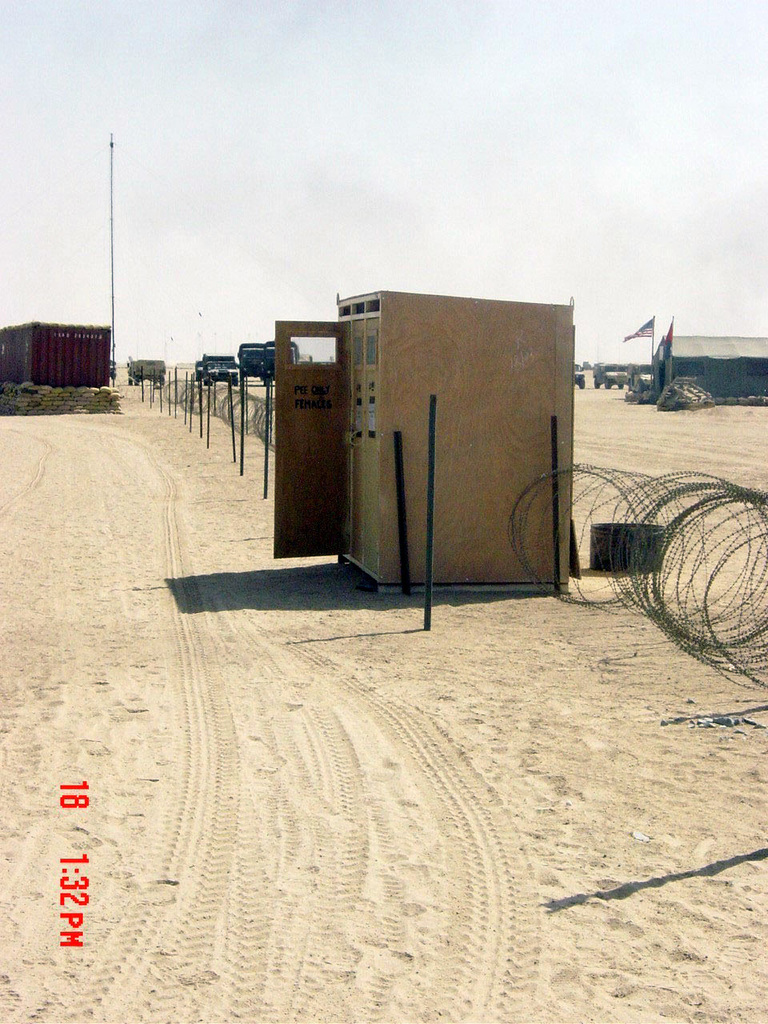 A modified (female only) field latrine set up at Camp New Jersey, Kuwait,  during Operation ENDURING FREEDOM - U.S. National Archives Public Domain  Image