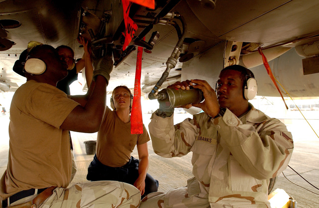 US Air Force (USAF) aircraft maintenance personnel deployed to the 363rd Expeditionary Aircraft Maintenance Squadron (EAMS), prepare a USAF F-15C Eagle aircraft for departure at a forward deployed location in Southwest Asia during Operation ENDURING FREEDOM