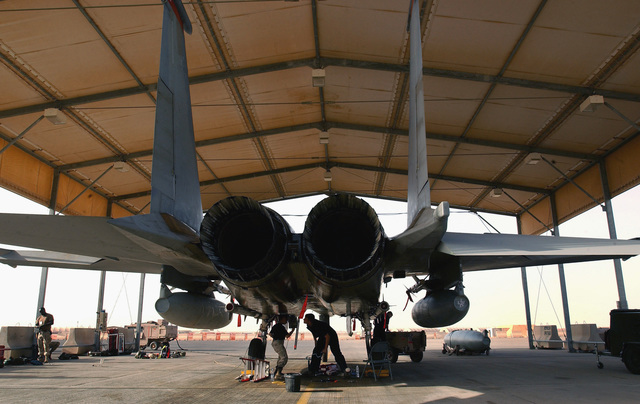 US Air Force (USAF) members, deployed to the 363rd Expeditionary Aircraft Maintenance Squadron (EAMS), prepare a USAF F-15C Eagle aircraft, 67th Fighter Squadron (FS), Kadena Air Base (AB), Japan, for departure at a forward deployed location in Southwest Asia during Operation ENDURING FREEDOM. The Eagle is armed with AIM-120C Advanced Medium Range Air-to-Air Missiles (AMRAAM) and AIM-9 Sidewinder missiles