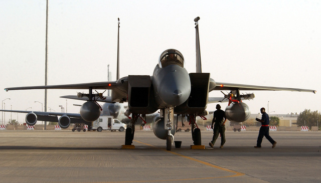 US Air Force (USAF) members, deployed to the 363rd Expeditionary Aircraft Maintenance Squadron (EAMS), check over a deployed USAF F-15C Eagle aircraft after a mission at a forward deployed location in Southwest Asia. The Eagle is armed with AIM-120A Advanced Medium Range Air-to-Air Missiles (AMRAAM) and AIM-9 Sidewinder missiles