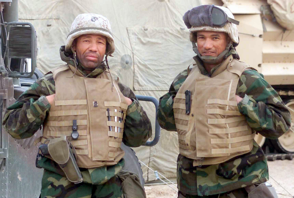 US Marine Corps (USMC) Sergeant Major (SGMAJ) Kennith Lucas and First Sergeant (1SGT) Hamilton, near the Combat Operations Center (COC)