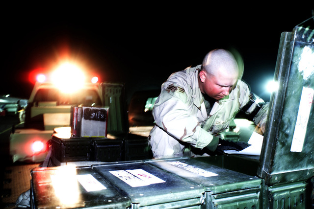 US Air Force (USAF) SENIOR AIRMAN (SRA) Keith Flesher, 379th Expeditionary Maintenance Squadron (EMXS), ammo troop, prepares to re-arm chaff flares for an aircraft at a forward deployed location in Southwest Asia during Operation ENDURING FREEDOM