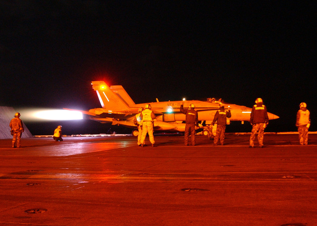 """An US Navy (USN) F/A-18 Hornet aircraft assigned to Strike Fighter Squadron One Five (VFA-15) """"Valions"""" readies for the squadrons first launch from the flight deck of the US Navy (USN) USN NIMITZ CLASS: Aircraft Carrier USS THEODOR ROOSEVELT (CVN 71), as Carrier Air Wing Eight (CWV-8) conducts flight operation in support of Operation IRAQI FREEDOM"""