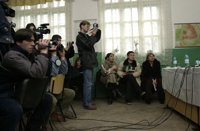 Local Romanian media ask questions during a media event where Mr. Paul Mocanu (not shown), Mayor of Nicola Balcescu, Romania, thanks US Air Force (USAF) Colonel (COL) Steven Dreyer (not shown), Commander, 458th Air Expeditionary Group (AEW), for a recent road construction project completed by the USAF a town near Mihail Kogalniceanu Air Base (AB), Romania, during Operation ENDURING FREEDOM
