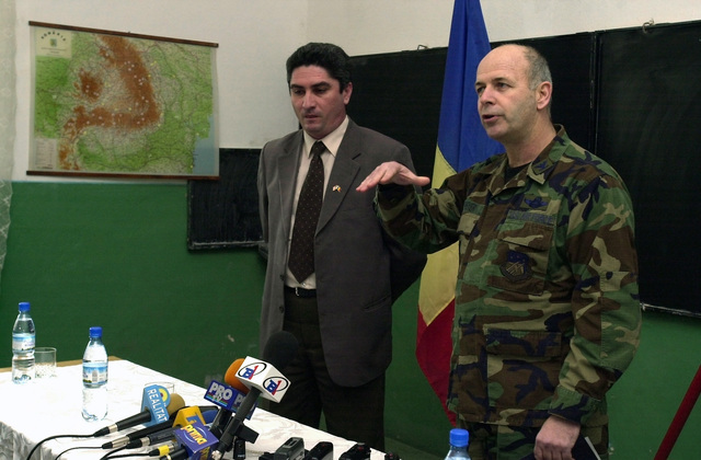 Mr. Paul Mocanu (left), Mayor of Nicola Balcescu, Romania, thanks US Air Force (USAF) Colonel (COL) Steven Dreyer, Commander, 458th Air Expeditionary Group (AEW), for a recent road construction project completed by the USAF a town near Mihail Kogalniceanu Air Base (AB), Romania, during Operation ENDURING FREEDOM
