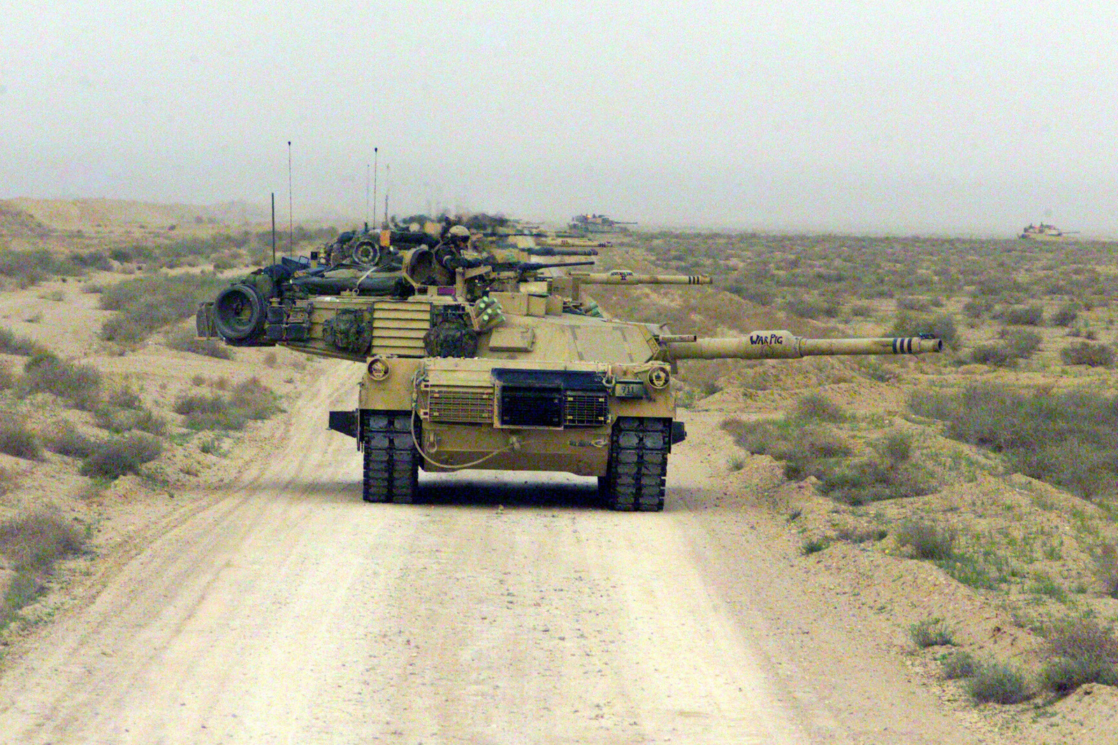 US Marine Corps (USMC) M1A1 Abrams Main Battle Tanks (MBT) with Charlie Company 1ST Tank Battalion, Twentynine Palms, California, line up and prepare to meet the enemy near Safwan Hill, Iraq during the opening shots of Operation IRAQI FREEDOM. IRAQI FREEDOM is the multinational coalition effort to liberate the Iraqi people, eliminate Iraq's weapons of mass destruction and end the regime of Saddam Hussein