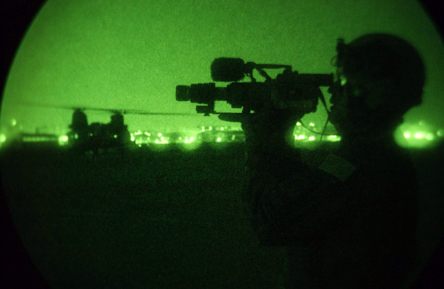 A nightscope view of US Air Force (USAF) Technical Sergeant (TSGT) David Smith, 4th Combat Squadron March Air Reserve Base (ARB), California (CA), as he documents the refueling of a CH-47 Chinook helicopter at Tague Air Base (AB), Korea. TSGT Smith is taking part in RECEPTION STAGING ONWARD MOVEMENT and INTEGRATION (RSO&I), and FOAL EAGLE which are joint and ined exercises for soldiers, sailors, airmen and Marines. They gather in Korea to work hand-in -hand with their South Korean counterparts for the purpose of showing the resolve of US forces to defend the Republic of Korea (ROK). It also gives the war fighters and planners an opportunity to operate in a joint (interservice) and...