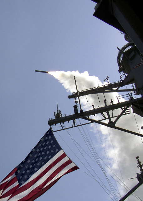 A Tomahawk Land Attack Missiles (TLAM) is launched from the US NAVY (USN) ARLEIGH BURK CLASS: (Flight IIA) Guided Missile Destroyer, USS Porter (DDG 78) toward Iraq during the initial stages of shock and awe, in support of Operation IRAQI FREEDOM