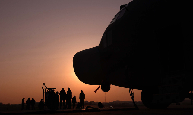 As night falls at Tague Air Base (AB), Korea, an MC-130H Combat Talon II sits in the foreground as the maintenance crew from the 1ST Special Operation Squadron (1ST SOS), Kadena AB, Okinawa, finish their day. The 1ST SOS is taking part in RECEPTION STAGING ONWARD MOVEMENT and INTEGRATION (RSO&I), and FOAL EAGLE which are joint and combined exercises for soldiers, sailors, airmen and Marines. They gather in Korea to work hand-in -hand with their South Korean counterparts for the purpose of showing the resolve of US forces to defend the Republic of Korea (ROK). It also gives the war fighters and planners an opportunity to operate in a joint (interservice) and combined (multinational)...