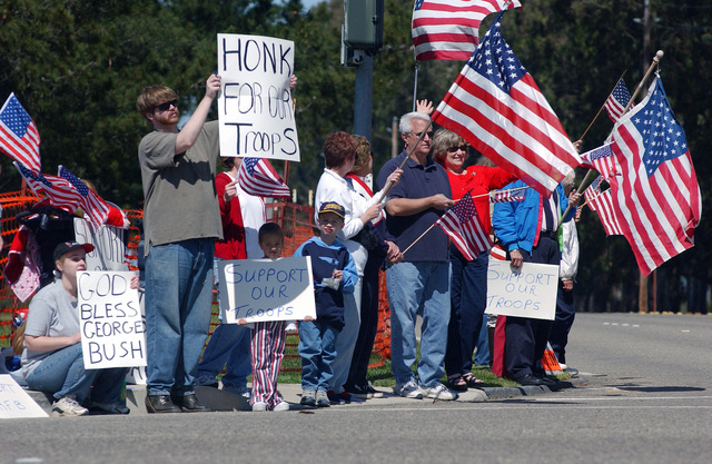 Exercising their First Amendment right, patriotic civilians occupy a corner at the entrance to Vandenberg Air Force Base (AFB), California (CA) in opposition to anti-war demonstrators