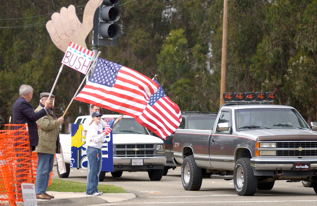 Showing support for the war in Iraq by wielding a self-crafted Thumbs-Up sign, Matt Kokkanen of San Luis Obispo, California (CA), and other patriotic civilians, occupied a corner at the entrance to Vandenberg Air Force Base (AFB), CA in opposition to some 40 anti-war demonstrators across the street