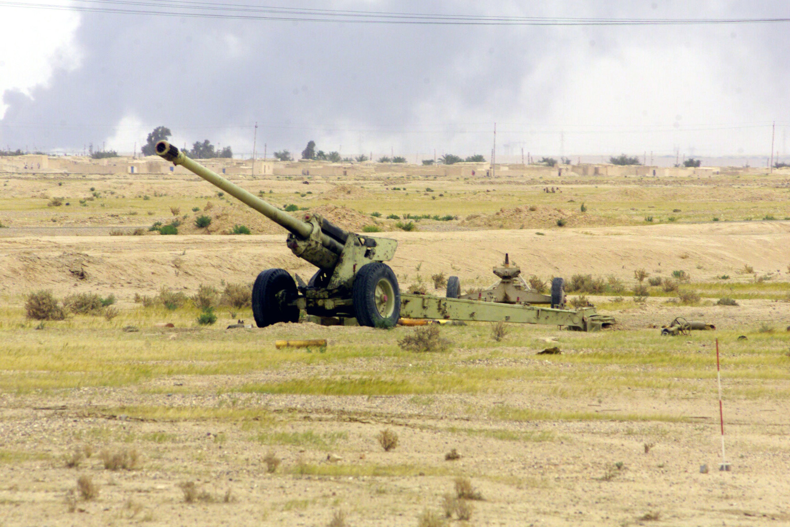 The remains of an Iraqi 130mm Field Gun M-46 and other