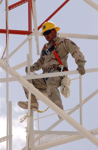 US Air Force (USAF) Technical Sergeant (TSGT) Carlos Ochoa, 379th Expeditionary Communications Squadron (ECS), assembles a Land Mobile Radios (LMR) Tower, at a forward deployed location during Operation IRAQI FREEDOM