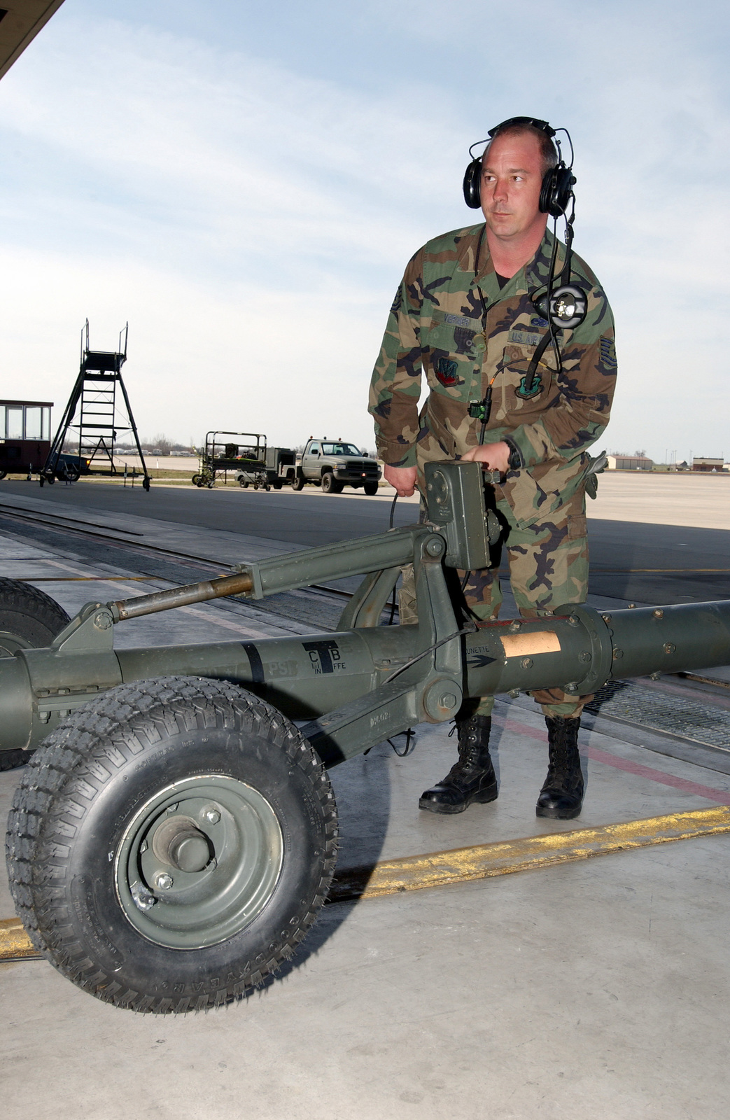 US Air Force (USAF) Technical Sergeant (TSGT) Steve Verner lowers the trailer wheels of a tow bar for a USAF B-2 Spirit. The aircraft was towed into a maintenance hanger at Whiteman Air Force Base (AFB)