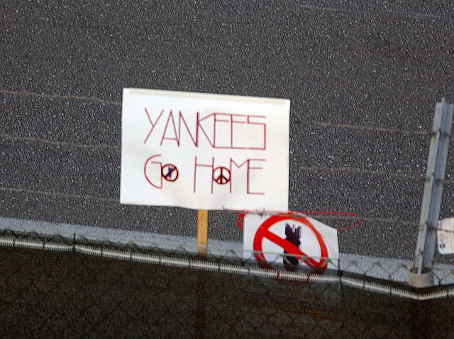 """A """"Yankees Go Home"""" protest sign at a scheduled anti-war protest at Aviano Air Base (AB), Italy"""