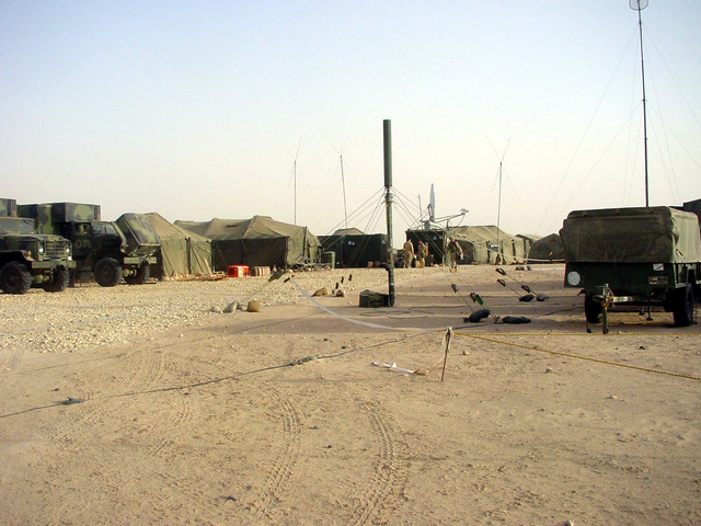 A US Army (USA) Helimast 15 Transportable Telescopic Antenna Mast (foreground) set up near the 101st Airborne Division's Rear (DREAR) general service and support area at Udayri Range, Kuwait, during Operation IRAQI FREEDOM