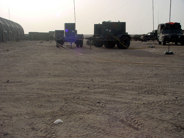 US Army (USA) portable 30-Kilowatt power supply generators set at the 101st Airborne Division Rear Theater of Operations Command (DREAR TOC) at Udayri Range in Kuwait, during Operation IRAQI FREEDOM