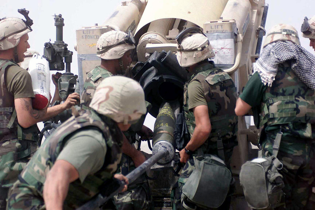US Marine Corps (USMC) Marines assigned to the 15th Marine Expeditionary Unit (MEU), prepare to fire an M 198 155mm howitzer at Umm Qasr, Iraq, during Operation IRAQI FREEDOM. 2003. The 15th MEU is deployed in support of Operation IRAQI FREEDOM