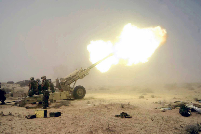 US Marine Corps (USMC) Marines assigned to the 15th Marine Expeditionary Unit (MEU), fire an M 198 155mm howitzer at Umm Qasr, Iraq, during Operation IRAQI FREEDOM. 2003. The 15th MEU is deployed in support of Operation IRAQI FREEDOM