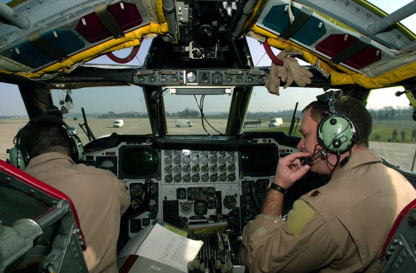 Inside the US Air Force (USAF) B-52H Stratofortress bomber, USAF Major (MAJ) Jeffrey (left), Aircraft Commander, and USAF MAJ Gregory, Pilot, 23rd Expeditionary Bomb Squadron (EBS), Minot Air Force Base (AFB), North Dakota (ND), perform final pre-flight checks prior to a mission against Iraqi targets, during Operation IRAQI FREEDOM