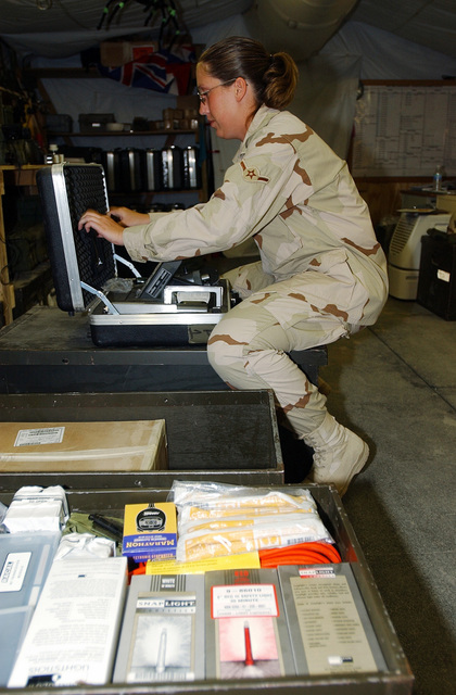 US Air Force (USAF) AIRMAN (AMN) Misty Collinson, Readiness Apprentice, 321st Expeditionary Civil Engineering Squadron (ECES), prepares to assemble the ADM-300 radiation detector at a forward-deployed location during Operation IRAQI FREEDOM. The ADM-300 detects alpha, beta, gamma and x-ray particles