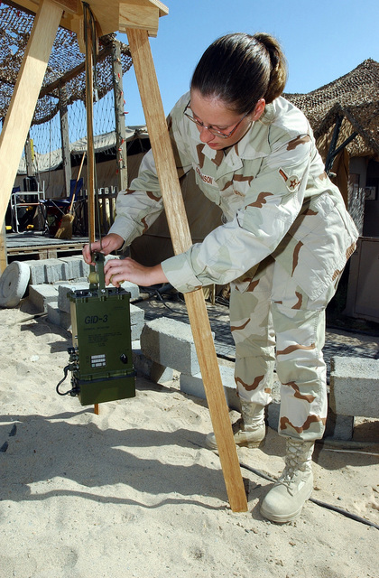US Air Force (USAF) AIRMAN (AMN) Misty Collinson, Readiness Apprentice, 321st Expeditionary Civil Engineering Squadron (ECES), performs a confidence check with a M22 Automatic Chemical Detector Alarm (ACADA) at a forward-deployed location during Operation IRAQI FREEDOM. The confidence check samples simulated G, nerve agent, and H, blister agents