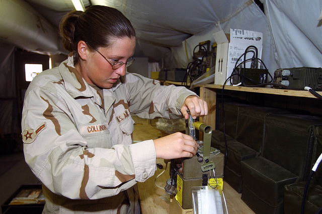 US Air Force (USAF) AIRMAN (AMN) Misty Collinson, Readiness Apprentice, 321st Expeditionary Civil Engineering Squadron (ECES), tests the airflow on a M8A1 automatic chemical agent alarm, a nerve agent detector, at a forward-deployed location during Operation IRAQI FREEDOM
