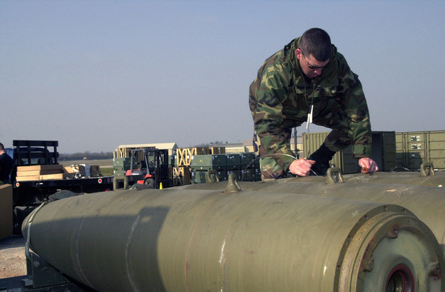 US Air Force (USAF) Technical Sergeant (TSGT) James Sutton, 9th Munitions Squadron (MUNS), Beale Air Force Base (AFB), California (CA), fuses Mark 84 (Mk-84) bombs at a forward-deployed location. Ammo troops build bombs before they are loaded onto the bombers. The base is currently home of the 457th Air Expeditionary Group (AEG), which is positioned to support Operation IRAQI FREEDOM