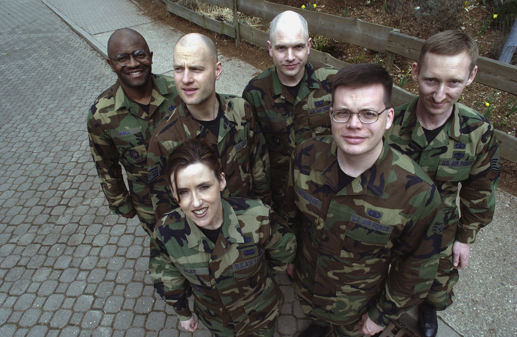 """Group shot of The United States Air Forces in Europe (USAFE) Band """"Galaxy."""" US Air Force (USAF) STAFF Sergeant (SSGT) Danny Hall (left), keyboards, USAF SSGT Tim Blake, Percussion, USAF SSGT Donna Siler, Vocals, USAF SENIOR AIRMAN (SRA) Michael Smith, Audio Technician, USAF SRA Toby McWilliams, Guitar, USAF MASTER Sergeant (MSGT) Jon Levy, Bass Guitar (right)"""