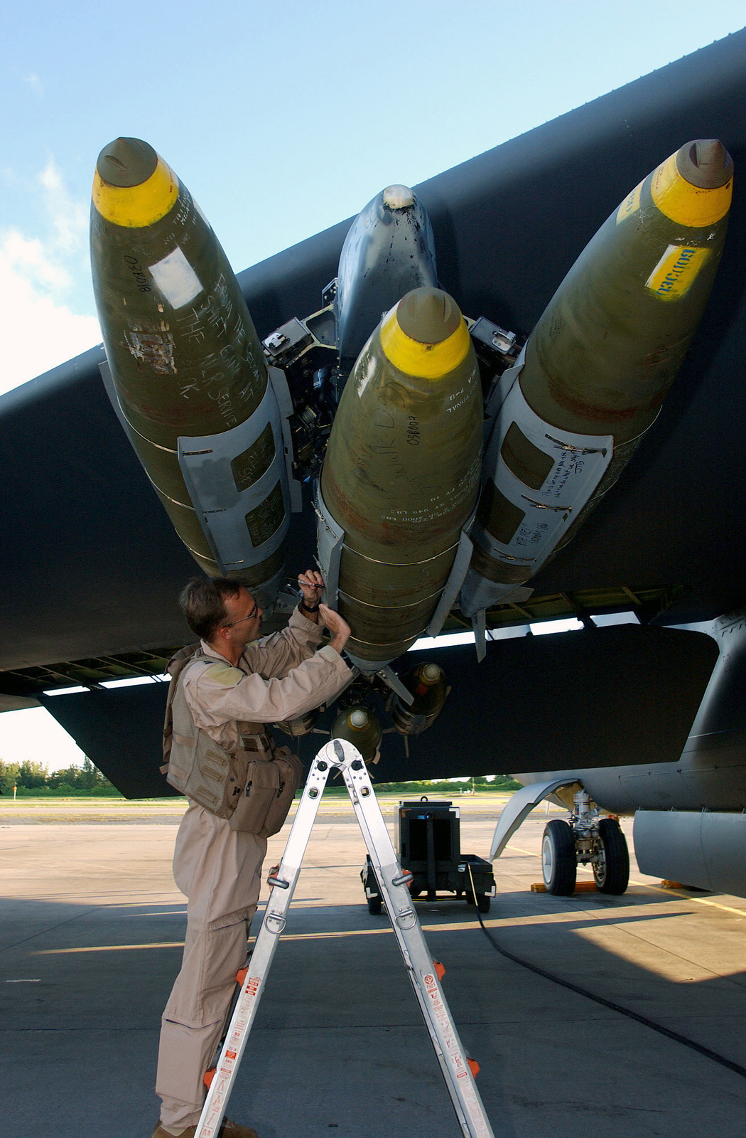 US Air Force (USAF) Captain (CAPT) Cameron Warren, Pilot, 40th Expeditionary Bomb Squadron (EBS), signs a Mk-84 Bomb JDAM (Joint Direct Attack Munition) before departing on his B-52H Stratofortress for a combat mission over Iraq during Operation IRAQI FREEDOM. Operation IRAQI FREEDOM is the multi-national coalition effort to liberate the Iraqi people, eliminate Iraqi's weapons of mass destruction and end the regime of Saddam Hussein