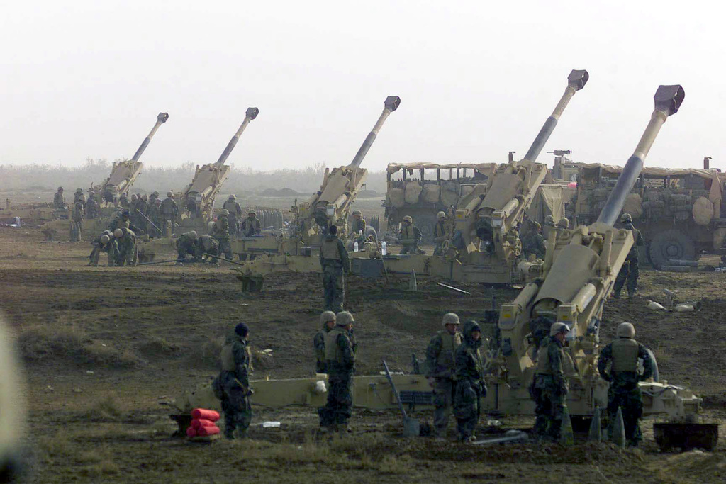 US Marine Corps (USMC) with India Battery, 3rd Battalion, 5th Marines, 1ST Marine Division out of Camp Pendleton, California, prepare to fire their in-line M198 155mm Medium Towed Howitzer artillery against possible enemy contact in Iraq during the early phase of Operation IRAQI FREEDOM