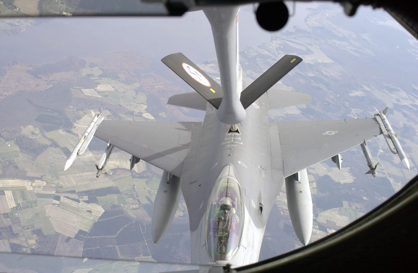 A US Air Force (USAF) F-16C Fighting Falcon aircraft, 177th Fighter Wing (FW), Atlantic City International Airport, New Jersey (NJ), receives JP8 fuel above the USA from a USAF KC-135R Stratotanker, 157th Air Refueling Wing (ARW), Pease Air National Guard Base (ANGB), New Hampshire (NH). This is a Combat Air Patrol (CAP) tanker mission in support of Operation NOBLE EAGLE. The F-16 is armed with AIM-120A Advanced Medium Range Air-to-Air Missiles (AMRAAM) on the wingtips and AIM-9 Sidewinder Missiles on the outboard pylons. In addition, it has two 370-gallon External Fuel Tanks for long loitering flight time