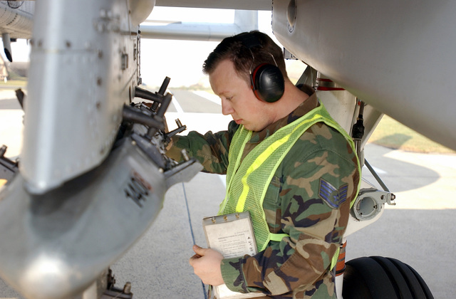 US Air Force (USAF) STAFF Sergeant (SSGT) Nathaniel R. Terry, Crewchief, 52nd Aircraft Maintenance Squadron (AMXS), performs last checks of an A-10 Thunderbolt II at the end of the taxiway before the aircraft enters the Spangdahlem Air Base (AB), Germany, runway
