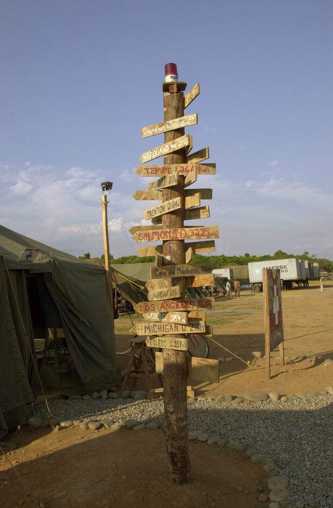"A wooden pole containing wooden placards pointing to the hometown directions of the U.S. Army Soldiers in the area can be seen outside of the medical tent at the Joint Task Force Chiriqui Base Camp""Amistad.""the home of New Horizons 03, Las Lajas, Chiriqui Province, Panama, on March 29, 2003. (U.S. Army photo by Kaye Richey) (Released)"