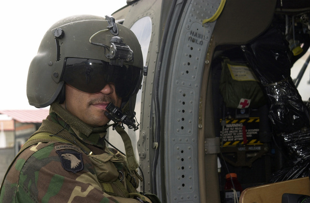 New Jersey Army National Guard (NJARNG) Sergeant (SGT) Frederick Derry, Crewchief, 150th General Support Aviation Battalion, West Trenton, New Jersey (NJ), prepares to board his US Army (USA) UH-60 Blackhawk (Black Hawk) helicopter to depart Albrook Airfield, Panama (PAN), en route to Chiriqui, PAN, in support of NEW HORIZONS 03