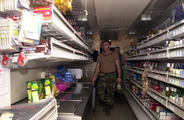 """U.S. Army Soldiers at the mobile Army and Air Force Exchange Service (AAFES) trailer purchase needed items while at the Joint Task Force Chiriqui Base Camp""""Amistad.""""the home of New Horizons 03, Las Lajas, Chiriqui Province, Panama, on March 29, 2003. (U.S. Army photo by Kaye Richey) (Released)"""