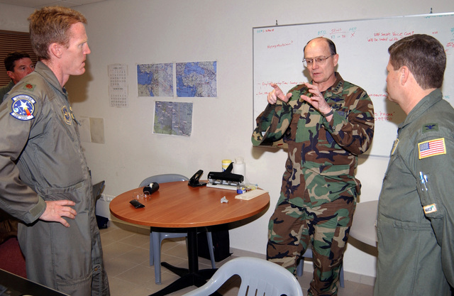 US Air Force (USAF) General (GEN) Gregory S. Martin (left) Commander, United States Air Forces in Europe (USAFE) speaks with Unit Commander from the 398th Air Expeditionary Group (AEG), during his visit at forward deployed operating base, during Operation ENDURING FREEDOM
