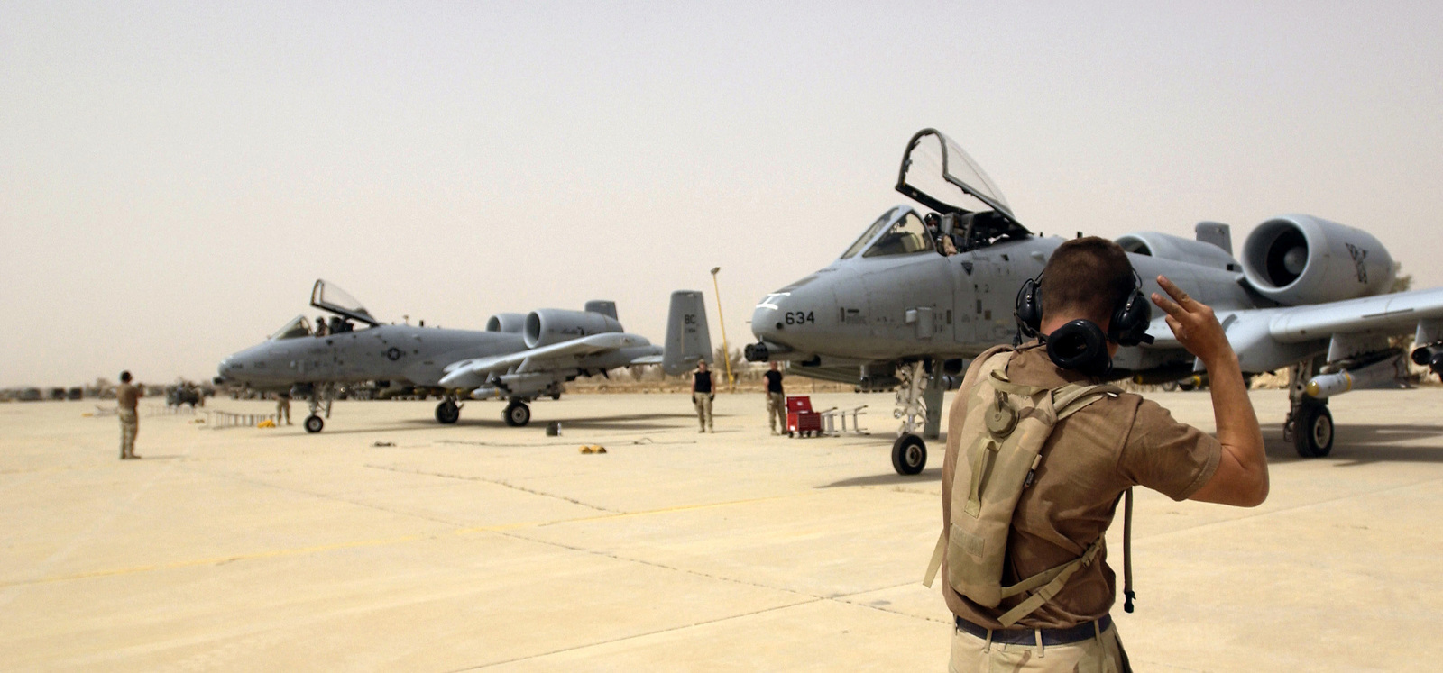 US Air Force (USAF) SENIOR AIRMAN (SRA) Rusty McRaney, Crew CHIEF, 392nd Air Expeditionary Wing (AEW), launches his A-10 Thunderbolt II aircraft on a mission at a forward deployed location in Southern Iraq, during Operation IRAQI FREEDOM