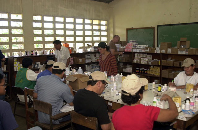 Medical Personnel from the Panama Ministry of Health fill prescriptions for the locals during a Medical Readiness Training Exercise (MEDERTE) in Quebrada Guabo, Panama, on April 1, 2003, as part of New Horizons 03.  (U.S. Army photo by Miguel A. Negron) (Released)