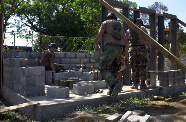 U.S. Army Soldiers, 612th Engineering Battalion, Ohio Army National Guard (OHANG), construct an addition to a school in Lajas Adentro, Panama, on April 1, 2003, during New Horizons 03.  (U.S. Army photo by Miguel A. Negron) (Released)