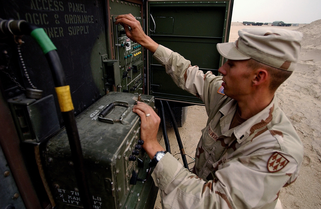 US Army (USA) SPECIALIST (SPC) Brandon Sapikowski, Launch Station Operator Maintainer, 35th Air Defense Artillery (ADA) Brigade, performs a operational check on a Launch Control Station for a MIM-104 Patriot Missile System located at Camp Arifjan, Kuwait, during Operation ENDURING FREEDOM
