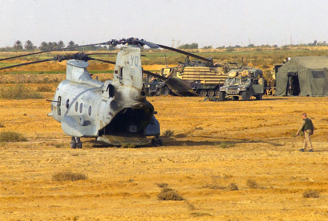A US Marine Corps (USMC) CH-46 Sea Knight helicopter sits in