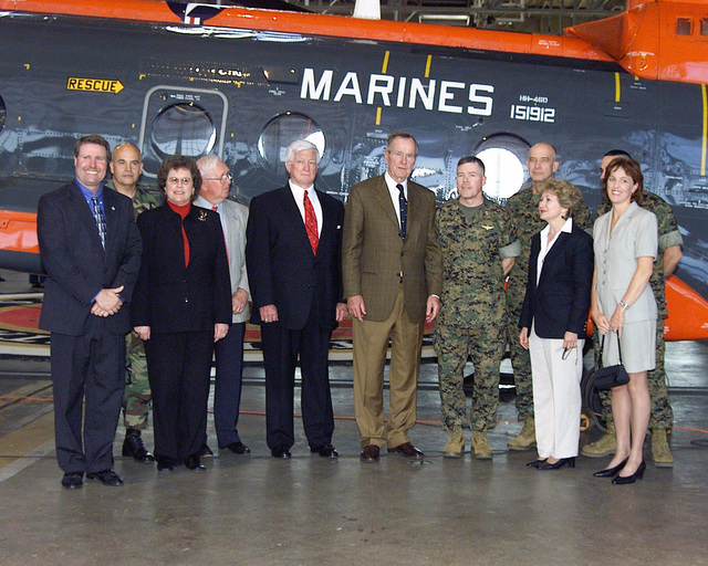 Former President George H. Bush poses for a group photograph with Major General (MGEN) Flannagen, Commanding General (CG) of Cherry Point, his wife Debra, MGEN Castellaw, CG of the 2nd Marine Air Wing (MAW), his wife Wanda (with purse), Colonel (COL) Kowalski, CHIEF of STAFF (hidden) and local officials, at MCAS Cherry Point