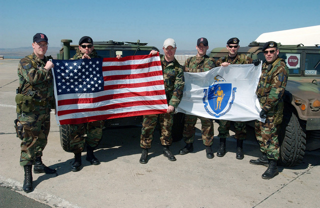 Proudly displaying the American and unit flags, US Air Force (USAF) AIRMAN from the 409th Air Expeditionary Group (AEG) pose for a photograph at Burgas Air Port (AP) near Camp Sarafovo, Bulgaria