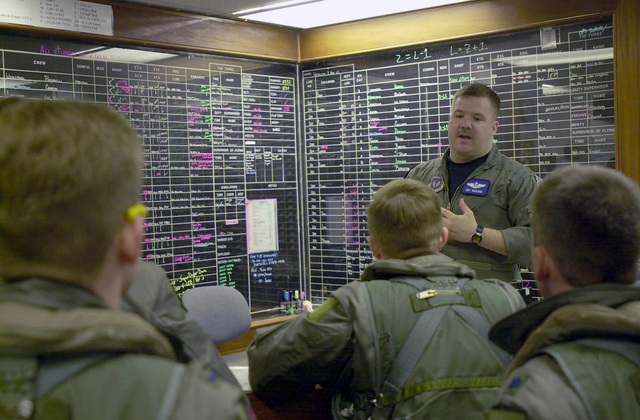 US Air Force (USAF) Major (MAJ) Jeff McCloud, an F-15E Eagle Fighter Pilot assigned to the 492nd Fighter Squadron (FS) at Royal Air Force (RAF), Lakenheath, England, conducts an aircrew pre-flight briefing confirming weather conditions and takeoff times