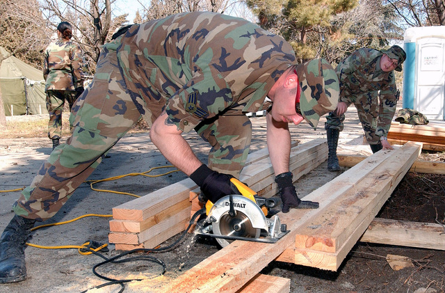 US Air Force (USAF) SENIOR AIRMAN (SRA) David Underdonk and SRA Karl Ferre, cut lumber for benches, while other personnel from the 100th Civil Engineer Squadron (CES), Royal Air Force (RAF) Mildenhall, England, assigned to nearby Camp Sarafovo, work to revive an old dilapidated amphitheater